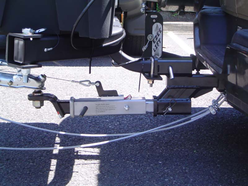 Close-up of dual hitch towing a smart car on vehicle with StowAway Standard Carrier