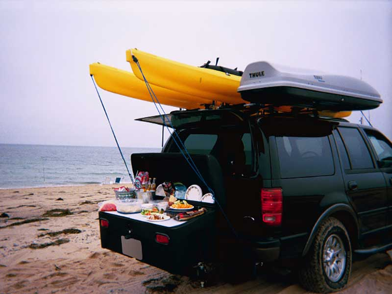 Picnic lunch laid out on StowAway Standard Carrier with buffet boards
