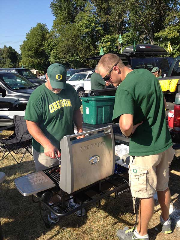 Oregon Duck fans tailgating with the Hitch Grill Station
