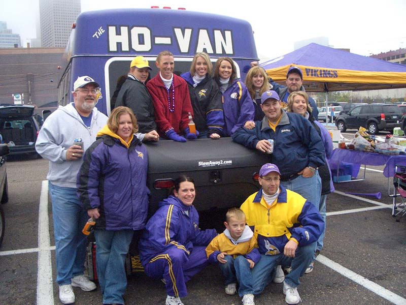 Vikings fans pose around their StowAway Standard Carrier