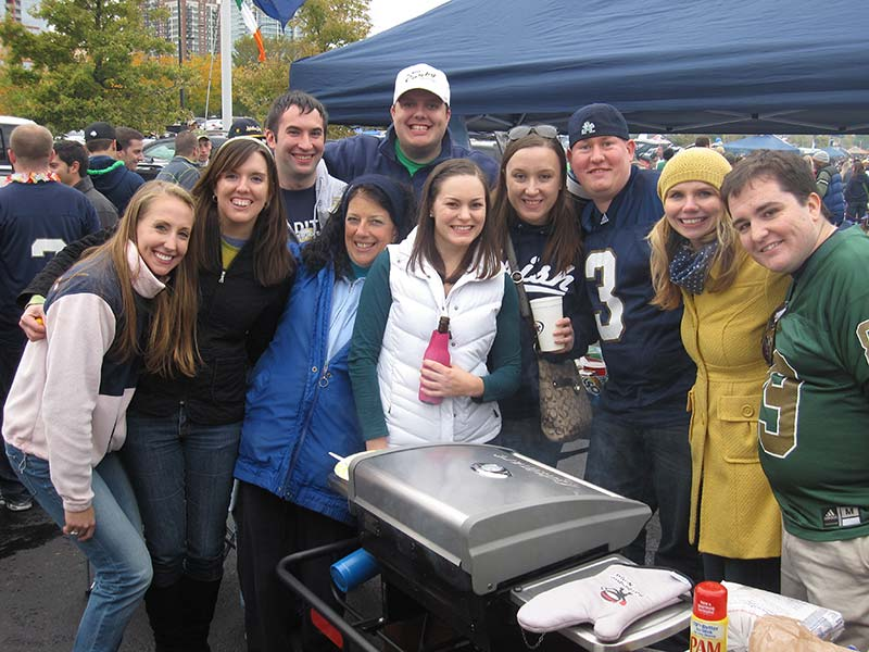 Group of fans tailgating at Notre Dame with Hitch Grill Station