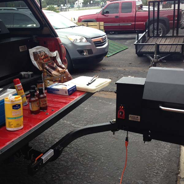 Smokin Brothers Grill mounted on SwingAway Frame with tailgate buffet