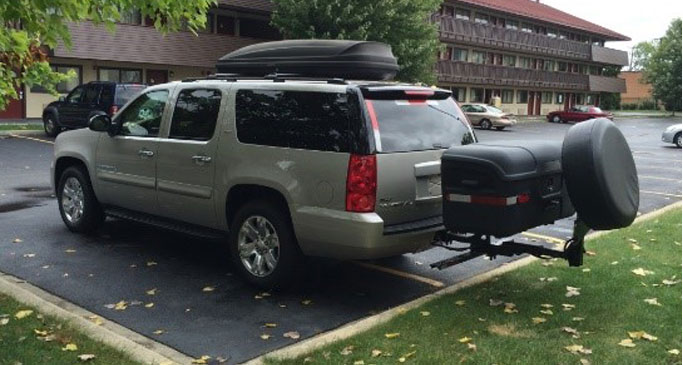 Stowaway cargo carrier on a SUV in parking lot