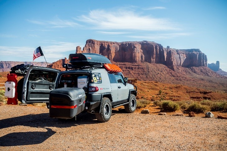 Stowaway carrier box on a Jeep in the Grand Canyon with back door opened
