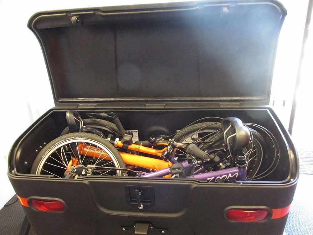 Two fold-up bikes inside a StowAway MAX Cargo Carrier