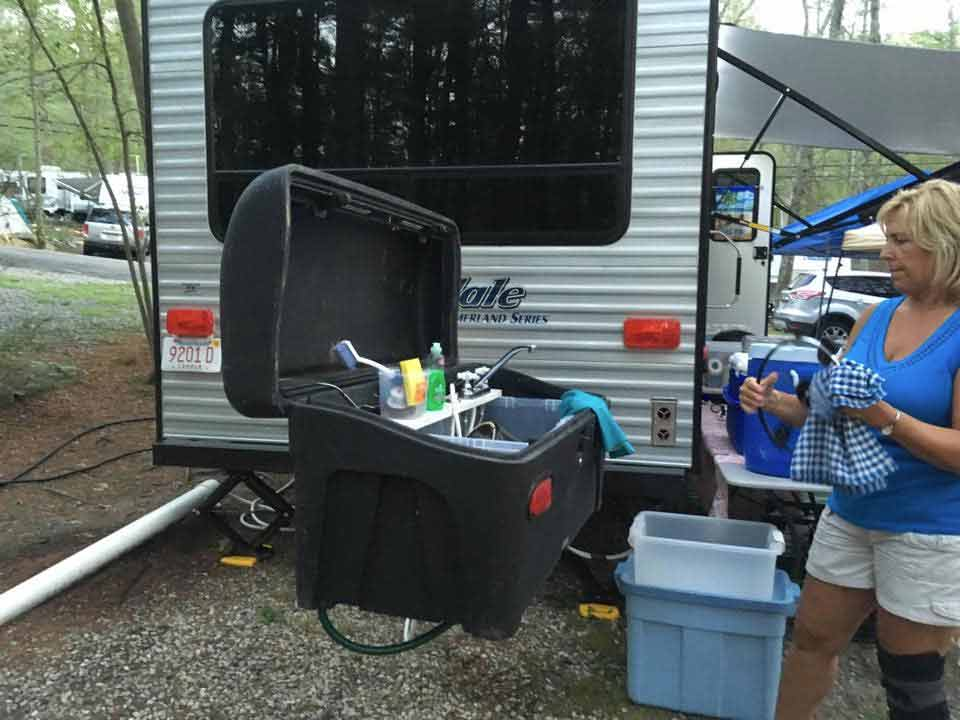 StowAway Standard Cargo Carrier converted into camping sink to wash dishes