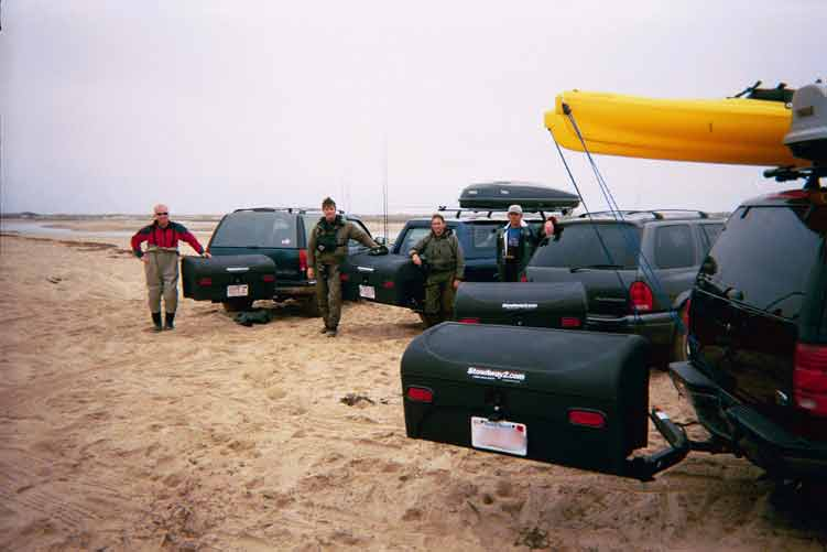 Fisherman with StowAway Standard Cargo Carriers on 4 vehicles at the beach
