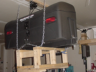 StowAway Standard Cargo Carrier hanging from garage ceiling on pulley system
