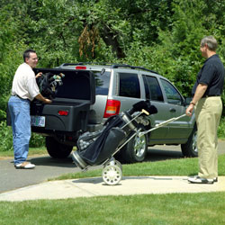 Two golfers using the StowAway Standard Cargo Carrier to store their golf gear