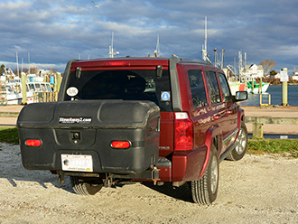 StowAway Standard Cargo Carrier on Jeep Grand Cherokee, parked at marina