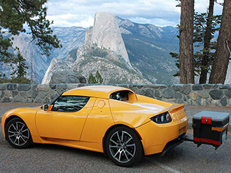 Cargo box mounted on StowAway Fixed Frame on Tesla Roadster