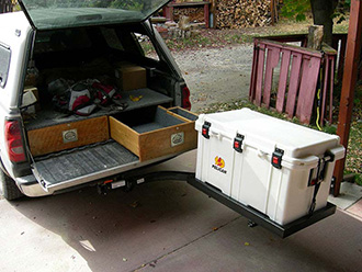 StowAway SwingAway Frame with custom platform holding Pelican cooler on Chevy pickup