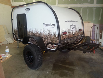 StowAway SwingAway Frame with custom platform on Mirror Lake Summit Camp teardrop trailer