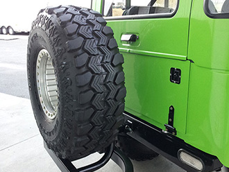 StowAway SwingAway Frame carring spare tire on Hummer H1