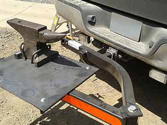 Farrier's anvil mounted on StowAway SwingAway Frame on Toyota Tundra