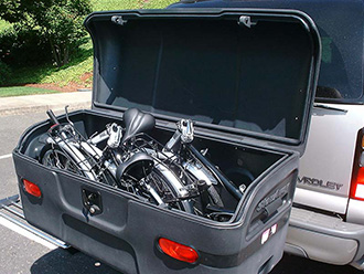 StowAway MAX Cargo Carrier on Chevy Suburban holding 2 folding bikes, open