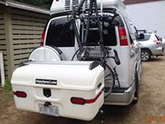 StowAway MAX Cargo Carrier on van with tandem bike on door-mounted bike rack