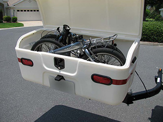 StowAway MAX Cargo Carrier with SwingAway frame holding 2 folding bikes, open