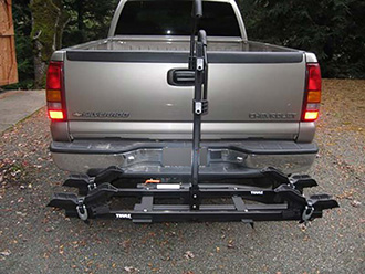StowAway SwingAway Frame on Chevy Silverado with Thule wheel-mounted bike rack, 2 bikes, SwingAway open