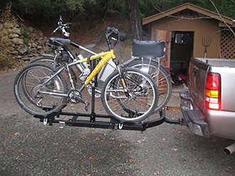 StowAway SwingAway Frame on Chevy Silverado with Thule wheel-mounted bike rack, 2 bikes, SwingAway closed