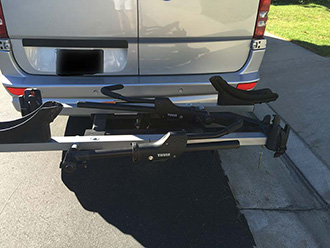 StowAway SwingAway Frame on Mercedes Sprinter van with Thule wheel-mounted bike rack, empty, closed