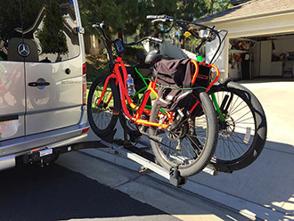 StowAway SwingAway Frame on Mercedes Sprinter van with Thule wheel-mounted bike rack, 2 bikes, open