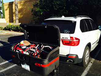 Two golf bags and equipment stored in StowAway MAX Cargo Carrier on BMW X5 SUV