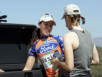 Two members of Ford-Basis women's cycling team, with StowAway Standard Cargo Carrier