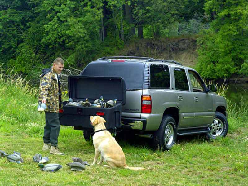 A duck hunter using the StowAway Standard Cargo Carrier to store his decoys and hunting gear