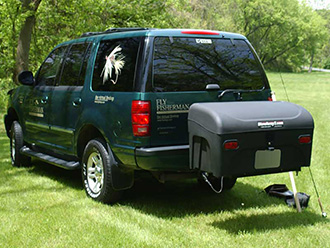 Fly Fisherman Ford Explorer with StowAway Standard Cargo Carrier