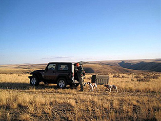 Hunter and two dogs with StowAway Standard Cargo Carrier on Jeep