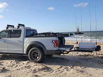 Ford pickup truck with StowAway Surf Fishing Rod Rack, tailgate open