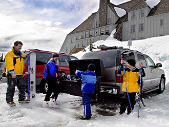 Family unloading GMC Yukon with StowAway Standard Cargo Carrier at Timberline Lodge, Mt. Hood, Oregon