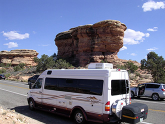 Leisure Travel Sprinter van with StowAway MAX Cargo Carrier driving in Canyonland National Park, Utah