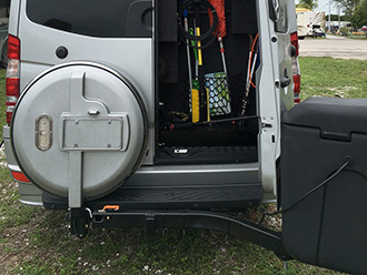Leisure Travel Mercedes Sprinter van with StowAway MAX Cargo Carrier swung out and rear door open