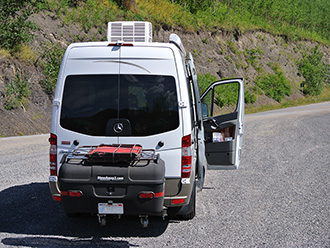 Mercedes Sprinter van with StowAway MAX Cargo Carrier on Alaska Highway, Yukon Territory, Canada
