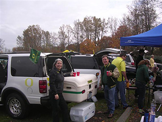 Oregon Ducks fans tailgating with white StowAway MAX Cargo Carrier