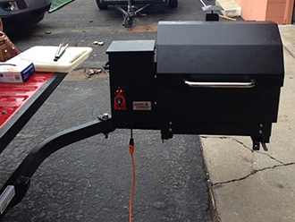 Pellet smoker mounted on StowAway SwingAway Frame