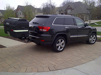 Audi Quattro with StowAway MAX Cargo Carrier with Carrier Lid Rack on a dual-mount hitch