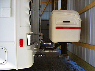RV with white StowAway MAX Cargo Carrier mounted on dual-hitch receiver