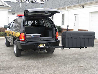 Police vehicle with liftgate open and StowAway Standard Carrier swung out