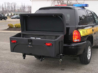 Police vehicle with StowAway Standard Cargo Carrier lid open