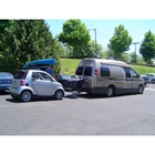 Van using a dual hitch receiver to carry StowAway Standard Cargo Carrier and tow a vehicle