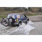 Motorcycle carrier mounted to StowAway SwingAway Frame on Toyota Land Cruiser