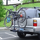 Stowaway bike rack with bikes on a light gray vehicle