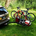 StowAway Bike & Cargo Rack holding 2 bikes, gear and a cooler swung out from vehicle