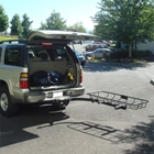 StowAway Hitch Mount Cargo Rack swings out of the way for full access to the vehicle